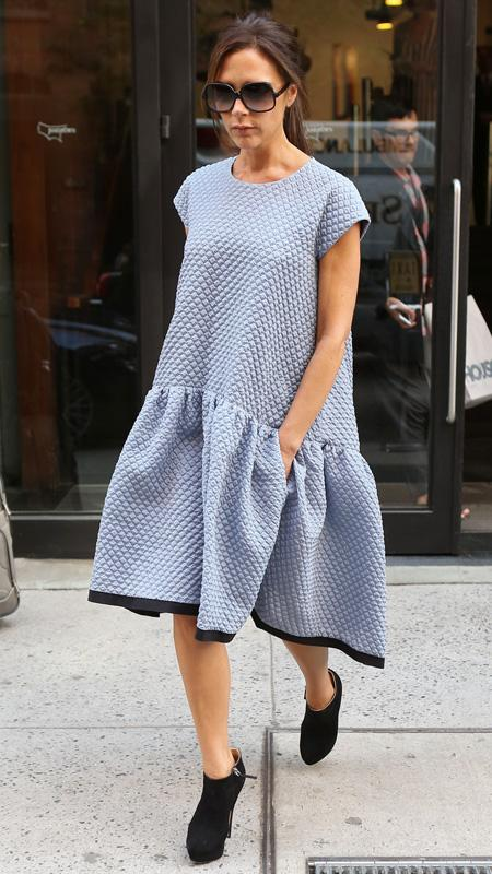 Victoria Beckham in light blue oversized dress and black booties
