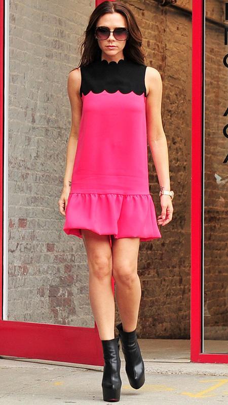Victoria Beckham wearing hot pink and black dress